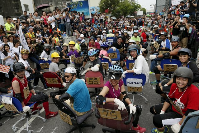 Competitors react before taking part in the office chair race ISU-1 Grand Prix in Tainan, southern Taiwan April 24, 2016. (Photo by Tyrone Siu/Reuters)