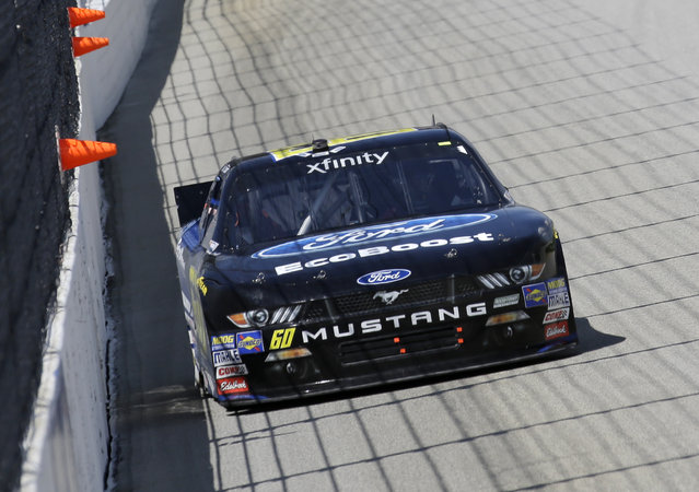 Chris Buescher (60) drives his car during the NASCAR Xfinity series auto race at Chicagoland Speedway, Sunday, June 21, 2015, in Joliet, Ill. (AP Photo/Nam Y. Huh)