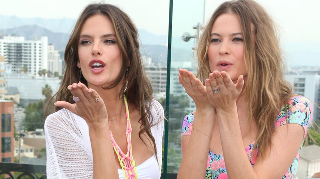 Alessandra Ambrosio and Behati Prinsloo promote Victoria's Secret 2014 Swim Collection at The London Hotel on March 11, 2014 in West Hollywood, California. (Photo by JB Lacroix/WireImage)