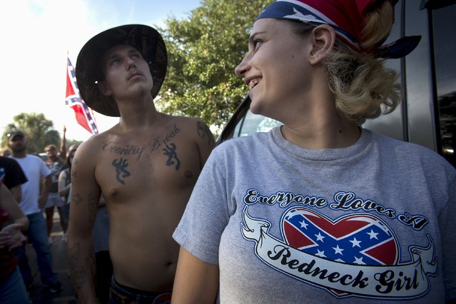 "Destiny Mooneyham, 18, from Tampa talks to Dennis Wiles, (L) 20, from Tampa before a ""Ride for Pride"" event to show support for the Confederate flag in Brandon, Hillsborough County, June 26, 2015. (Photo by Carlo Allegri/Reuters)"