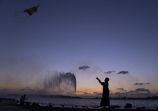 A boy flies a kite on the Red Sea beach near the landmark Jiddah fountain in Jiddah, Saudi Arabia, Monday, February 20, 2017. (Photo by Amr Nabil/AP Photo)