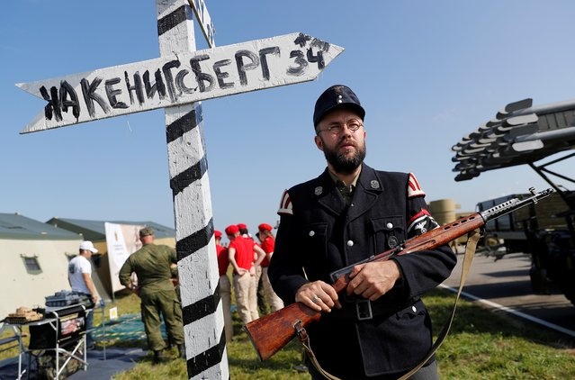 A man dressed in historical uniform takes part at the International Army Games 2019 at the at Khmelevka firing ground on the Baltic Sea coast in Kaliningrad Region, Russia on August 13, 2019. (Photo by Vitaly Nevar/Reuters)