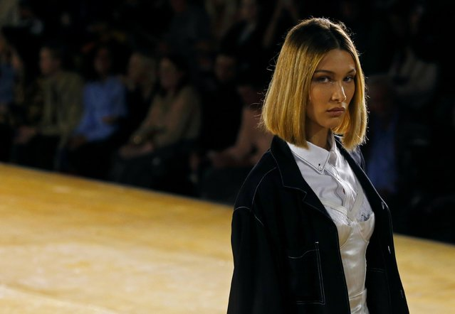 Model Bella Hadid presents a creation during the Burberry catwalk show at London Fashion Week in London, Britain, September 16, 2019. (Photo by Henry Nicholls/Reuters)
