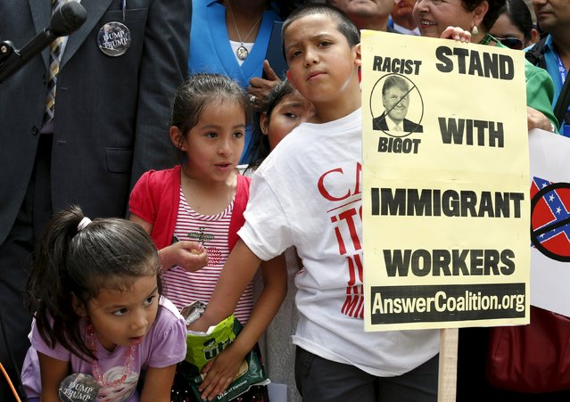 Children participate in a protest calling for businesses to sever their relationships with U.S. Republican presidential candidate Donald Trump over his recent comments about Mexican immigrants as they demonstrate outside the site of a new hotel owned by Trump at the Old Post Office Building in Washington July 9, 2015. (Photo by Yuri Gripas/Reuters)