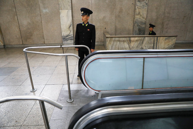 A railway worker stands by escalators at a subway station visited by foreign reporters, in central Pyongyang, North Korea on April 14, 2017. (Photo by Damir Sagolj/Reuters)