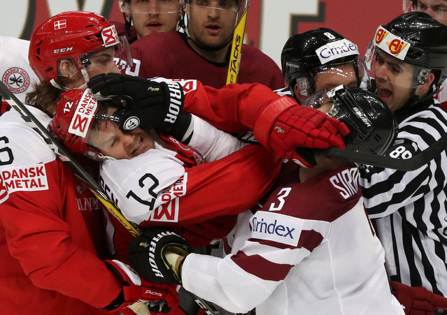 Ice Hockey, 2016 IIHF World Championship, Group A, Denmark vs Latvia, Moscow, Russia on May 13, 2016. Denmark's Mads Christensen fights with Latvia's Maksims Sirokovs. (Photo by Grigory Dukor/Reuters)