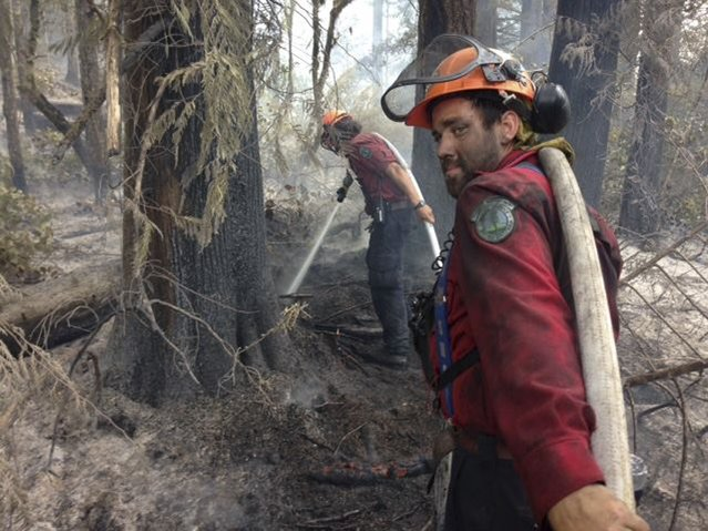A fire-fighting crew extinguishes hot spots on the Dog Mountain wildfire, near Port Alberni, British Columbia in a picture release by the BC Wildfire Service July 11, 2015. The wildfire is now 100% contained. (Photo by Reuters/BC Wildfire Service)
