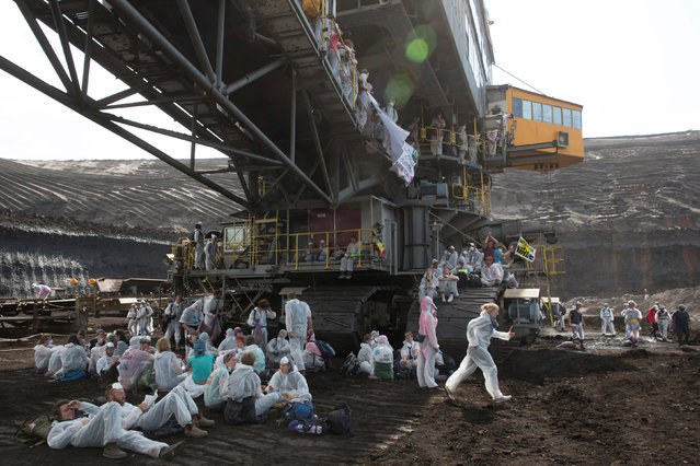 Activists protest at the open-cast mine of Welzow-Sued near the eastern German town of Welzow, Germany, May 13, 2016. (Photo by Reuters/Stringer)