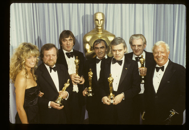 The 52nd Annual Academy Awards, backstage coverage. Airdate: April 14, 1980. Presenters Farrah Fawcett and Harold Russell (R) with best visual effects Oscar winners (2nd From L-R): H.R. Giger, Carlo Rambaldi, Brian Johnson, Nick Allder and Denys Ayling. (Photo by ABC Photo Archives/ABC via Getty Images)