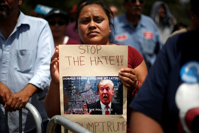 Supporter Maria Antonio waits for U.S. Democratic presidential candidate Bernie Sanders to speak in East Los Angeles, California, U.S. May 23, 2016. (Photo by Lucy Nicholson/Reuters)