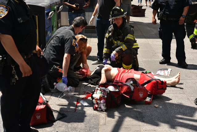 Emergency services tend to an injured pedestrian after a vehicle struck pedestrians on a pavement in New York on May 18, 2017. (Photo by Erik Pendzich/Rex Features/Shutterstock)