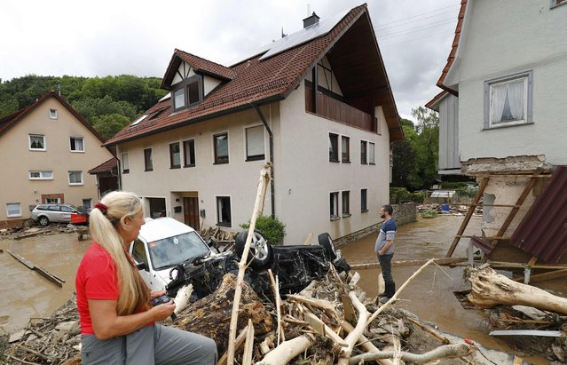 People look at the damage caused by the floods in the town of Braunsbach, in Baden-Wuerttemberg, Germany, May 30, 2016. (Photo by Kai Pfaffenbach/Reuters)