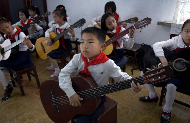 School children practice a song during their guitar class, Thursday, May 7, 2015, in Pyongyang, North Korea. (Photo by Wong Maye-E/AP Photo)