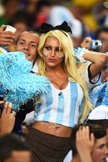 Argentina fans take a selfie in the crowd prior to the 2014 FIFA World Cup Brazil Group F match between Argentina and Bosnia-Herzegovina at Maracana on June 15, 2014 in Rio de Janeiro, Brazil. (Photo by Matthias Hangst/Getty Images)