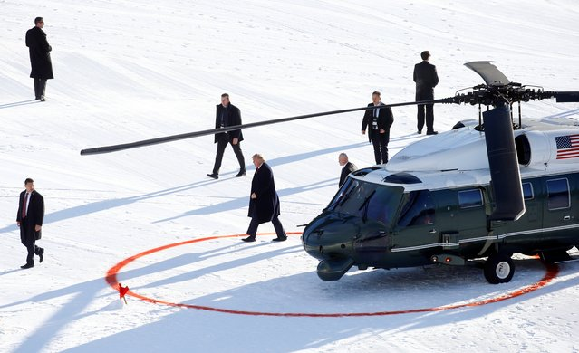U.S. President Donald Trump walks out of the Marine One helicopter as he arrives for the 50th World Economic Forum (WEF) in Davos, Switzerland, January 21, 2020. (Photo by Arnd Wiegmann/Reuters)