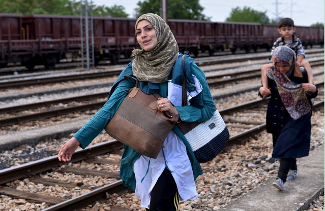 Migrants arrive from Greece at the train station in Gevgelija near the Greek border with Macedonia July 30, 2015. (Photo by Ognen Teofilovski/Reuters)