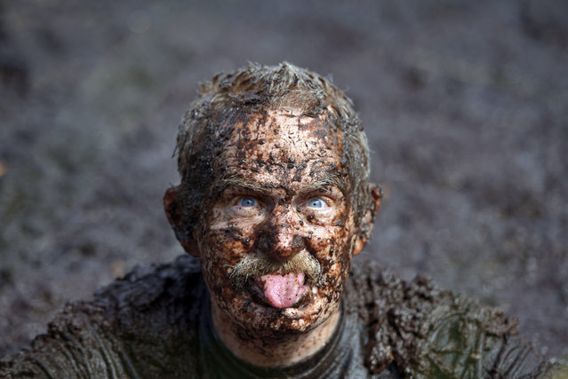 A male entrant takes a dip in the so called Bog Jacuzzi after takes part in the Irish Bog Snorkelling championship this afternoon at Peatlands Park on July 27, 2014 in Dungannon, Northern Ireland. The annual event sees male and female competitors swim the 60m length of the bog watched by scores of spectators and takes place on International Bog Day. (Photo by Charles McQuillan/Getty Images)
