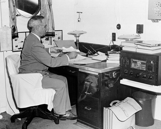 In this August 6, 1945, file photo, aboard the cruiser Augusta, President Harry S. Truman, with a radio at hand, reads reports of the first atomic bomb raid on Japan, while en route home from the Potsdam conference. On two days in August 1945, U.S. planes dropped two atomic bombs, one on Hiroshima, one on Nagasaki, the first and only time nuclear weapons have been used. Their destructive power was unprecedented, incinerating buildings and people, and leaving lifelong scars on survivors, not just physical but also psychological, and on the cities themselves. Days later, World War II was over. (Photo by AP Photo)