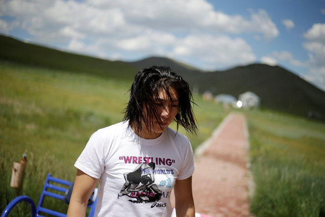 Mongolia's Olympic wrestler Battsetseg Soronzonbold walks toward the dormitory after a daily training session at the Mongolia Women's National Wrestling Team training centre in Bayanzurkh district of Ulaanbaatar, Mongolia, July 1, 2016. (Photo by Jason Lee/Reuters)
