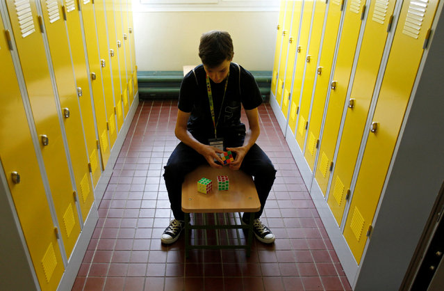 A competitor solves a Rubik's cube as he prepares for the Rubik's Cube European Championship in Prague, Czech Republic, July 15, 2016. (Photo by David W. Cerny/Reuters)