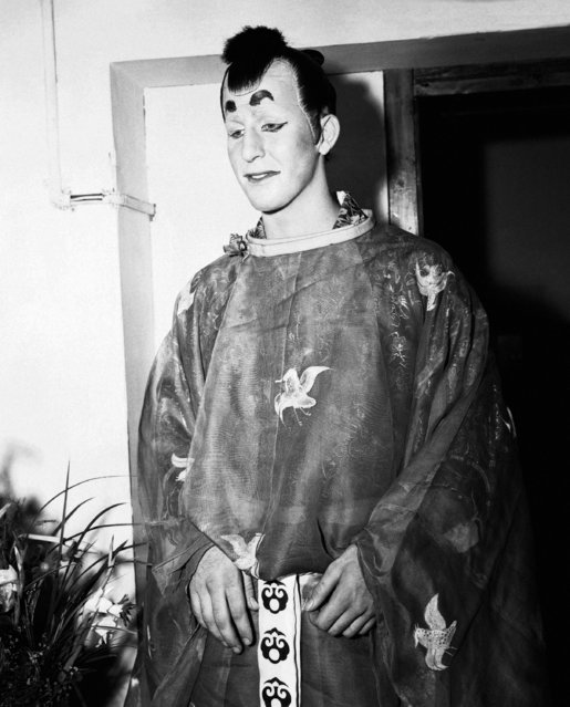 "Pfc. Stanley Hughes, of Canon City, Colorado, the Nobel Lord ""Rish-Tush"" in the GI presentation of the ""Mikado"" at the Ernie Pyle Theatre in Tokyo, Japan on August 25, 1946, awaits his cue before going on the stage. The special services detachment production unit of the Eighth Army in Japan produced the show. (Photo by Charles Gorry/AP Photo)"