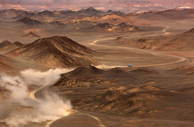 Kamaz truck team Airat Mardeev and co-driver Aydar Belyaev compete in the Gobi Desert on July 18, 2016 during the 9th special stage of the Silkway Rally. One hundred-thirty competitors are racing 10,734 kms, passing three countries and two continents from Moscow to Beijing. (Photo by Patrick Baz/AFP Photo)