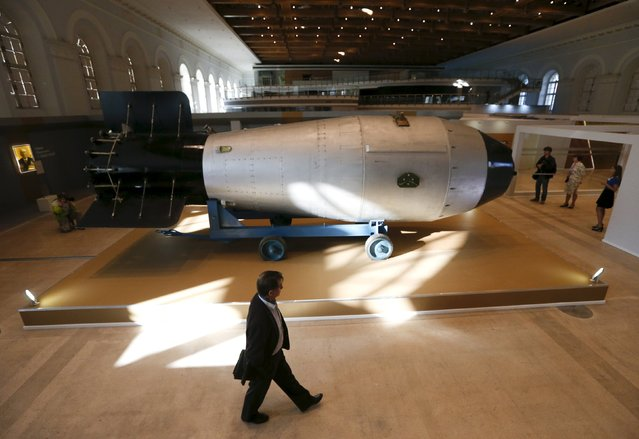 A man walks past a shell, which is the replica of the biggest detonated Soviet nuclear bomb AN-602 (Tsar-Bomb), in Moscow, Russia, August 31, 2015. (Photo by Maxim Zmeyev/Reuters)