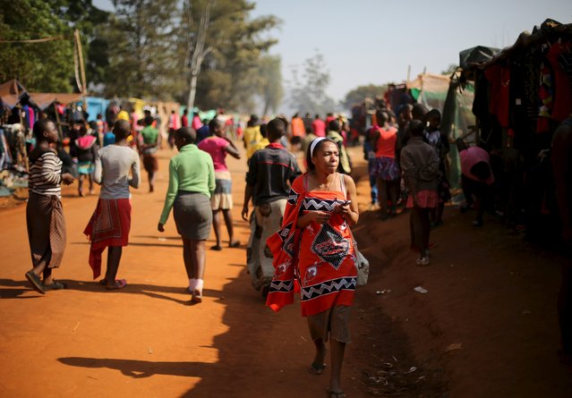 A maiden walks in a market ahead of the last day of the Reed Dance at Ludzidzini Royal Palace in Swaziland August 31, 2015. (Photo by Siphiwe Sibeko/Reuters)