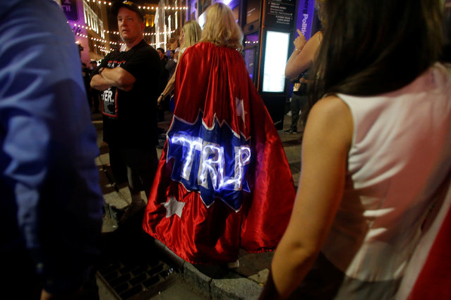 An attendee wearing a Trump cape exits the arena of the Republican National Convention in Cleveland, Ohio, U.S., July 22, 2016. (Photo by Jim Urquhart/Reuters)