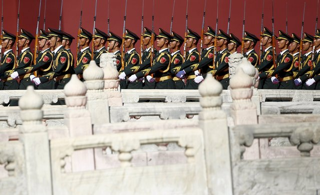 Soldiers of China's People's Liberation Army (PLA) march at the beginning of the military parade marking the 70th anniversary of the end of World War Two, in Beijing, China, September 3, 2015. (Photo by Damir Sagolj/Reuters)