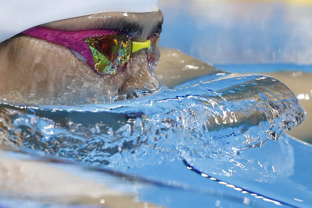 China's Shi Jinglin competes in a Women's 200m Breaststroke heat during the swimming event at the Rio 2016 Olympic Games at the Olympic Aquatics Stadium in Rio de Janeiro on August 10, 2016. (Photo by Odd Andersen/AFP Photo)
