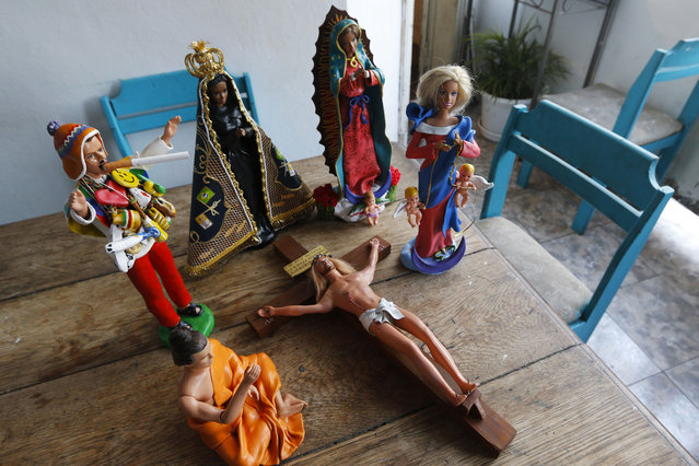 Argentinian artists Emiliano Paolini turn Barbie and Ken dolls into religious figures. (Photo by Enrique Marcarian/Reuters)
