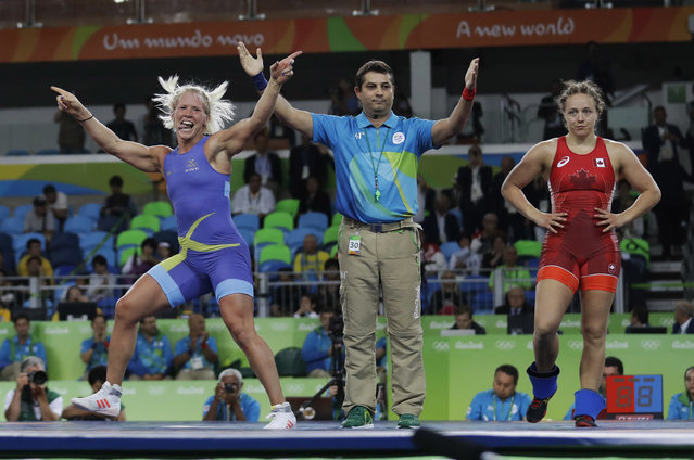 Sweden's Anna Jenny Fransson, left, celebrates after beating Canada's Dorothy Erzsebet Yeats in the women's wrestling freestyle 69-kg competition bronze medal round at the 2016 Summer Olympics in Rio de Janeiro, Brazil, Wednesday, August 17, 2016. (Photo by Markus Schreiber/AP Photo)