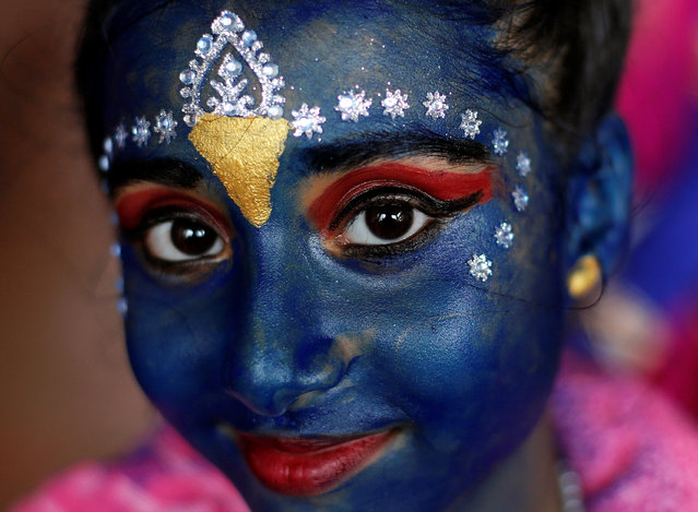 A student participates in celebrations ahead of the Janmashtami festival, which marks the birth anniversary of Lord Krishna in Mumbai, India, August 23, 2016. (Photo by Danish Siddiqui/Reuters)