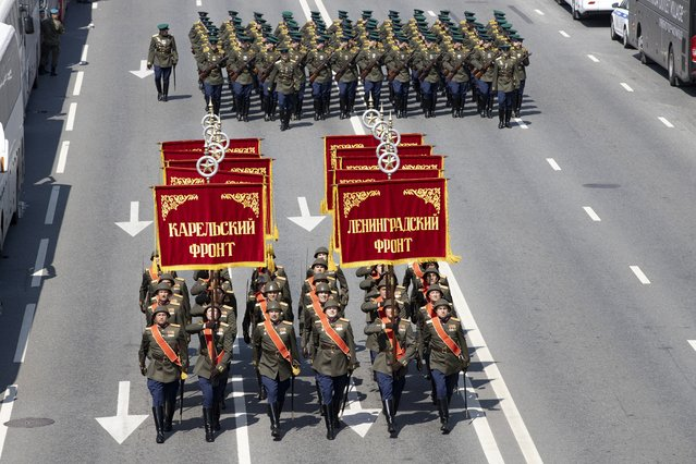 In this file photo taken on Saturday, June 20, 2020, Russian soldiers wearing WWII-era uniforms march toward Red Square to attend a dress rehearsal for the Victory Day military parade in Moscow, Russia. (Photo by Alexander Zemlianichenko/AP Photo/File)