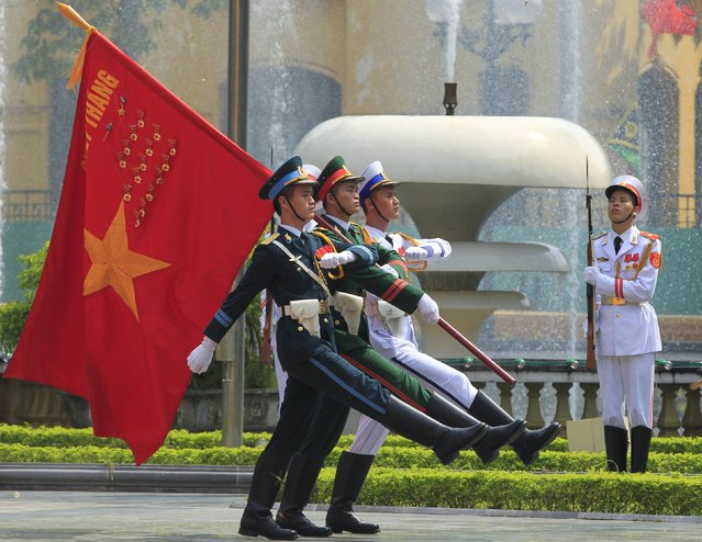 Members of honour guard march during a welcoming ceremony for Vanuatu's Prime Minister Joe Natuman at the Presidential Palace in Hanoi October 6, 2014. (Photo by Reuters/Kham)