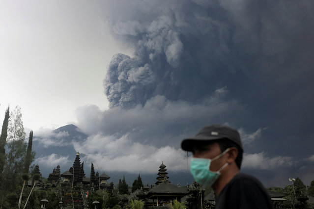 Mount Agung volcano erupts as seen from Besakih Temple in Karangasem, Bali, Indonesia on November 26, 2017. (Photo by Johannes P. Christo/Reuters)