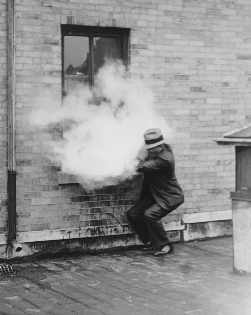"""An experimental """"mechanical guard"""" to protect children and adults within a home, shoots out a burst of tear gas to repel would-be criminals. The device is demonstrated by Lloyd Curtiss, engineer of federal laboratories, Pittsburgh, Pa., May 17, 1932. (Photo by AP Photo)"""