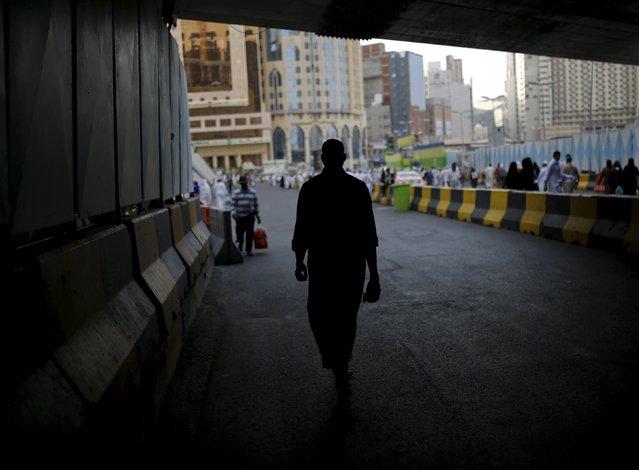 A Muslim pilgrim walks under a bridge in the holy city of Mecca ahead of the annual haj pilgrimage September 21, 2015. (Photo by Ahmad Masood/Reuters)