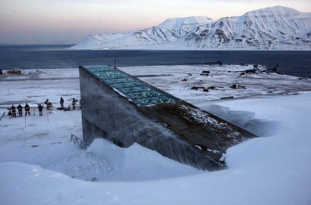 Snow blows off the Svalbard Global Seed Vault before being inaugurated at sunrise, Tuesday, February 26, 2008. (Photo by John McConnico/AP Photo)