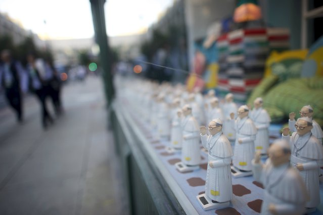 Pope Francis figurines are seen on a window display in Philadelphia, Pennsylvania, September 23, 2015. Pope Francis will travel to Philadelphia in his six-day visit to the United States. (Photo by Mark Makela/Reuters)