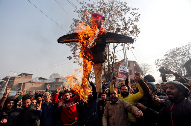 Demonstrators burn an effigy depicting U.S. President Donald Trump during a protest against the U.S. decision to recognize Jerusalem as the capital of Israel, in Srinagar December 8, 2017. (Photo by Danish Ismail/Reuters)
