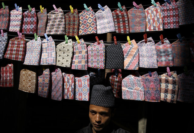 Traditional Nepalese hats which are necessary during rituals for worship during the Tihar festival, also called Diwali, are displayed for sale along a street in Kathmandu October 20, 2014. (Photo by Navesh Chitrakar/Reuters)