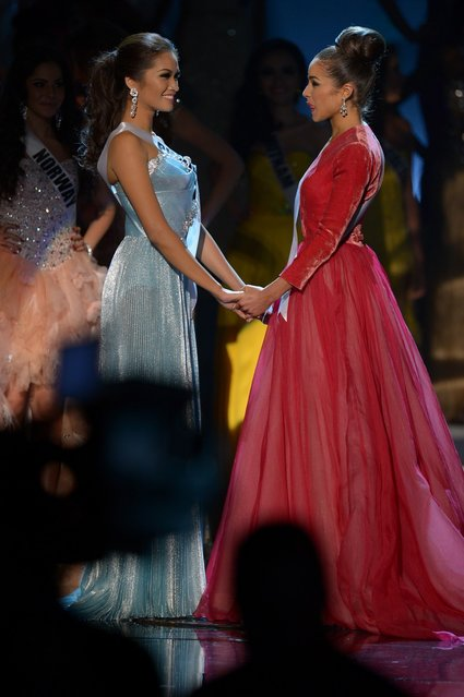 Miss Philippines,  Janine Tugonon (L), and Miss USA, Olivia Culpo (R), await the judges' final decision during the Miss Universe Pageant at Planet Hollywood in Las Vegas, Nevada on December 19, 2012. Olivia Culpo was crowned Miss Universe 2012,  beating out beauties from around the world to claim the coveted title.  The title of first runner-up title went to the contestant from the Philippines, Janine Tugonon. (Photo by Joe Klamar/AFP Photo)