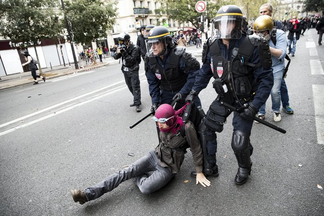 A protester is arrested by French Riot Police during a demonstration against the new labor law in Paris, France, 15 September 2016. The controversial reforms already voted into law, aims to bring down France's unemployment rate of around 10 percent by making the French labour laws more flexible. (Photo by Etienne Laurent/EPA)