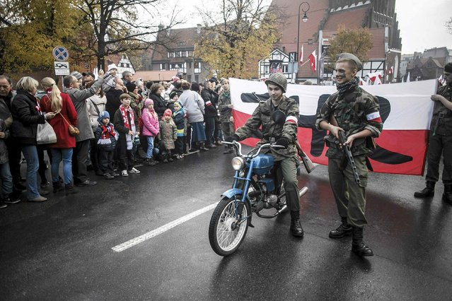 Youths parade wearing World War Two uniforms during the Independence Day celebrations in Gdansk November 11, 2014. (Photo by Lukasz Glowala/Reuters/Agencja Gazeta)