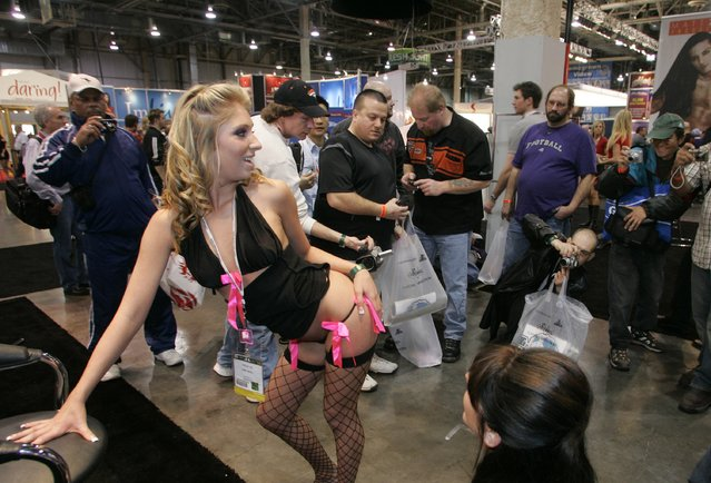 Adult film actress Jaelyn Fox poses for fans at the Pink Visual booth during the AVN (Adult Video News) Adult Entertainment Expo in Las Vegas, Nevada January 10, 2008. (Photo by Steve Marcus/Reuters)