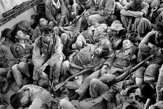 In this August 1962 file photo shot by Associated Press photographer Horst Faas, South Vietnamese government troops from the 2nd Battalion of the 36th Infantry sleep in a U.S. Navy troop carrier on their way back to the Provincial capital of Ca Mau, Vietnam. Faas, a prize-winning combat photographer who carved out new standards for covering war with a camera and became one of the world's legendary photojournalists in nearly half a century with The Associated Press, died Thursday May 10, 2012. He was 79. (Photo by Horst Faas/AP Photo)