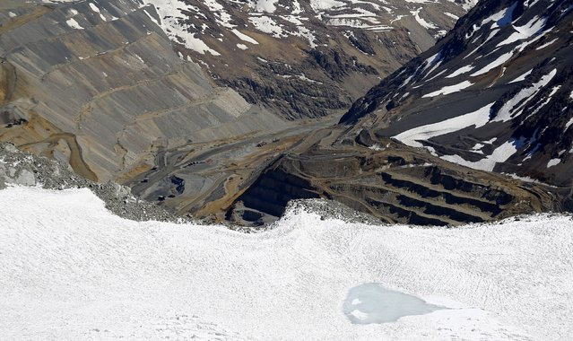 An aerial view of Olivares glacier with CODELCO'S Andina copper mine in the background at Los Andes Mountain range, near Santiago city, November 17, 2014. (Photo by Ivan Alvarado/Reuters)