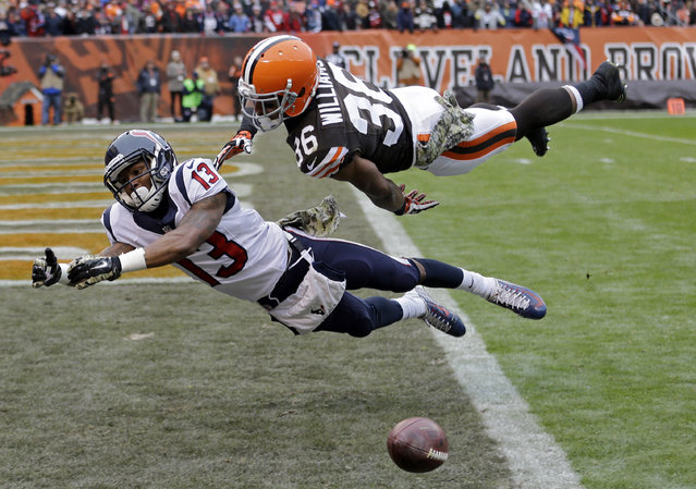 Cleveland Browns defensive back K'Waun Williams (36) breaks up a pass in the end zone against Houston Texans wide receiver Damaris Johnson in the first quarter of an NFL football game Sunday, November 16, 2014, in Cleveland. (Photo by Tony Dejak/AP Photo)